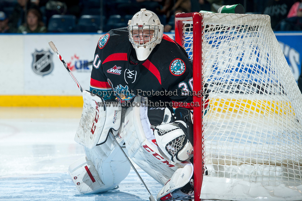 KELOWNA, CANADA - OCTOBER 19: Jordon Cooke #30 of the Kelowna Rockets defends the net against the Prince George Cougars on October 19, 2013 at Prospera Place in Kelowna, British Columbia, Canada.   (Photo by Marissa Baecker/Shoot the Breeze)  ***  Local Caption  ***
