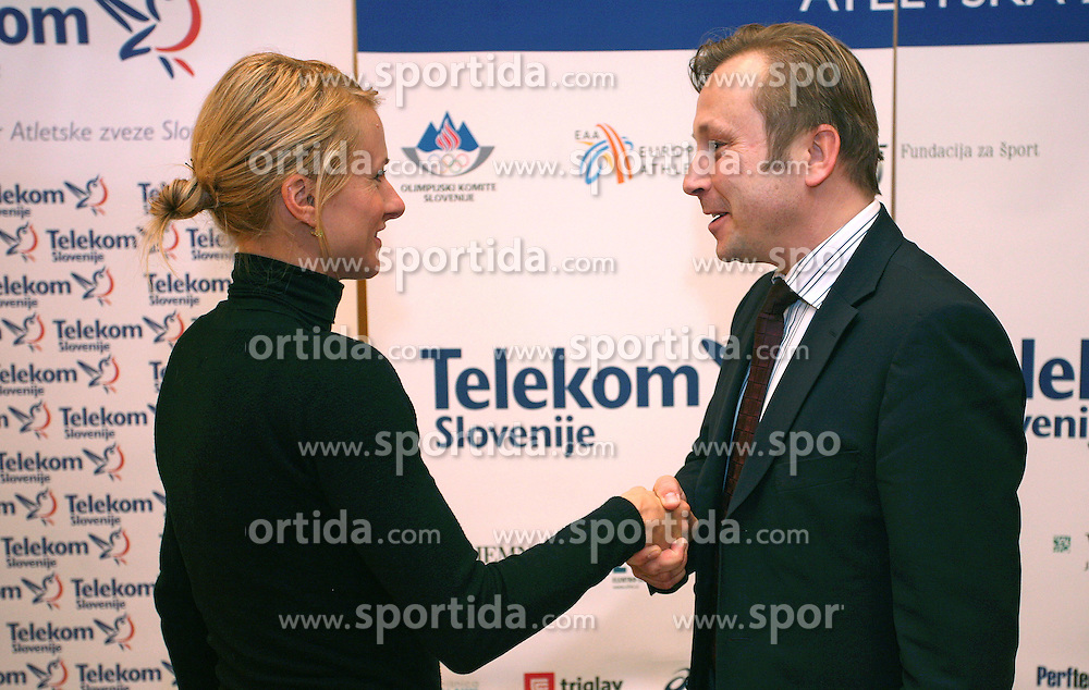 Brigita Langerholc and president of AZS dr. Peter Kukovica when Athletic Federation of Slovenia (AZS) and top Slovenian athletes sign a contract of sponsorship, on February 14, 2008 in M-Hotel, Ljubljana, Slovenia. (Photo by Vid Ponikvar / Sportal Images)