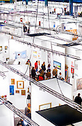 Aerial view of art show-goers browsing the huge Art Basel Miami Beach 2003 art fair in the Miami Beach Convention Center