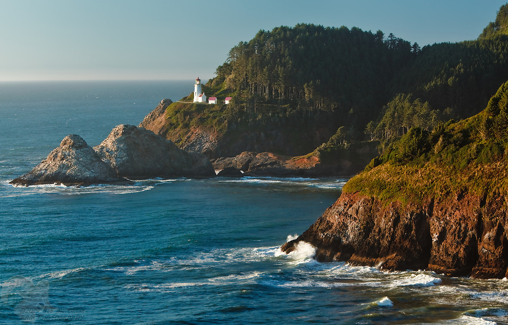The Haceta Lighthouse shines on a clear day along the Oregon Coast between Florence and Lincoln City, Oregon.