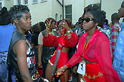 Girls dancing together, Notting Hill Carnival, UK, 2000's