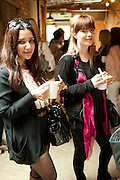NINA EKBARI; EMMA LIPPOLD, Design Your Own Timberland breakfast and Autumn/ Winter 2011 preview. Timberland. 1 Fournier St. London. Followed by an art tour by Julia Royce. 8 June 2011. <br /> <br />  , -DO NOT ARCHIVE-© Copyright Photograph by Dafydd Jones. 248 Clapham Rd. London SW9 0PZ. Tel 0207 820 0771. www.dafjones.com.