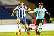 Wigan's Jake Buxton (3) and Derby's Jamie Hanson (26) during the EFL Sky Bet Championship match between Wigan Athletic and Derby County at the DW Stadium, Wigan, England on 3 December 2016. Photo by Craig Galloway.