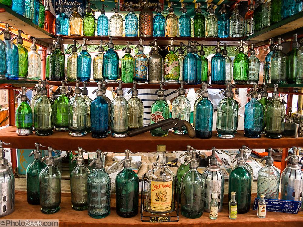 "Glass pump soda bottles. See a street fair in San Telmo (""Saint Pedro González Telmo""), the oldest barrio (neighborhood) of Buenos Aires, Argentina."