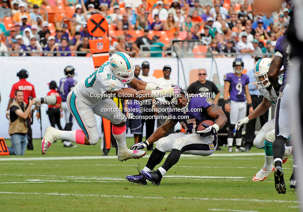 06 October 2013: Miami Dolphins defensive end Olivier Vernon (50) tackles Baltimore Ravens running back Ray Rice (27) in Baltimore's 26-23 victory at Sun Life Stadium, Miami, Florida.