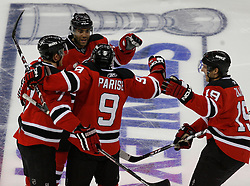 Apr 15, 2009; Newark, NJ, USA; The New Jersey Devils celebrate a goal by New Jersey Devils left wing Zach Parise (9) during the second period of game one of the eastern conference quarterfinals of the 2009 Stanley Cup playoffs at the Prudential Center.