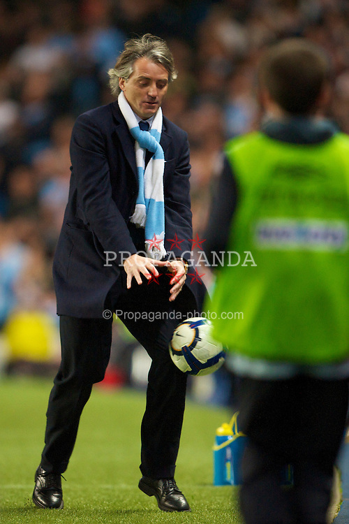 MANCHESTER, ENGLAND - Wednesday, May 5, 2010: Manchester City's oldest ball-boy manager Roberto Mancini during the Premiership match against Tottenham Hotspur at City of Manchester Stadium. (Photo by David Rawcliffe/Propaganda)