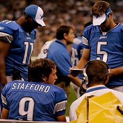 2009 September 13: Detroit Lions rookie quarterback Matthew Stafford (9) talks with teammates Daunte Culpepper (11) and Drew Stanton (5) on the bench during a 45-27 win by the New Orleans Saints over the Detroit Lions at the Louisiana Superdome in New Orleans, Louisiana.