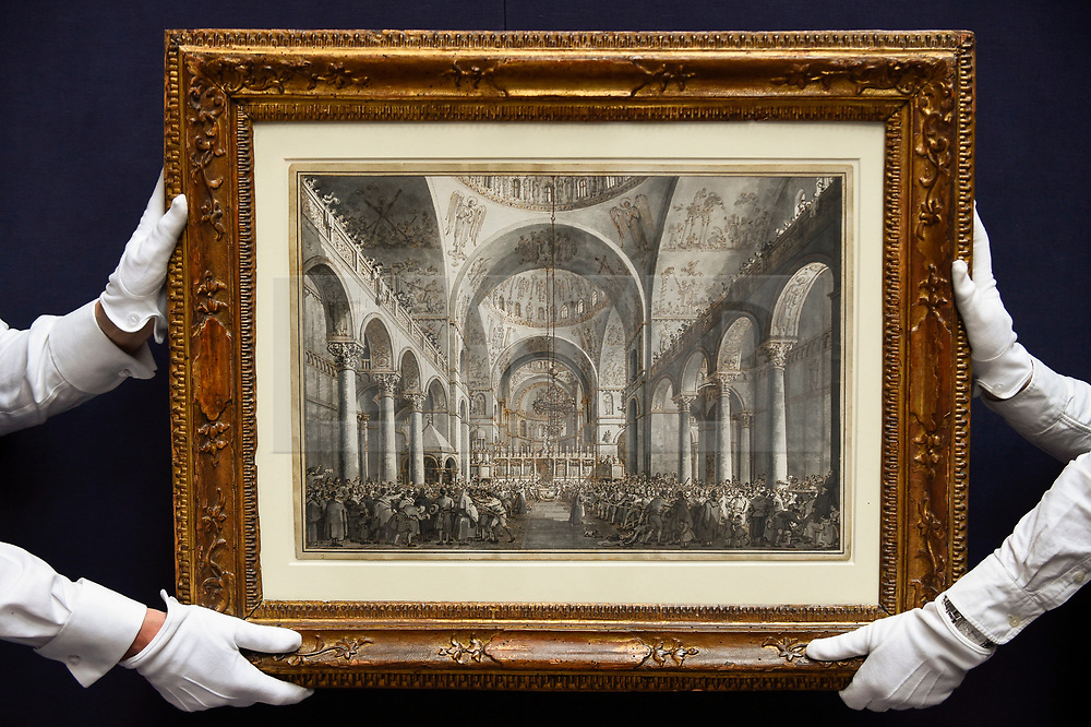 """© Licensed to London News Pictures. 28/06/2019. LONDON, UK. Technicians present """"The Presentation of the Doge in San Marco"""" by Giovanni Antonio Canal (Canaletto) (Est. GBP1.5-2m) at the preview of Sotheby's Old Masters sale which takes place at its New Bond Street galleries on 3 July.  Photo credit: Stephen Chung/LNP"""