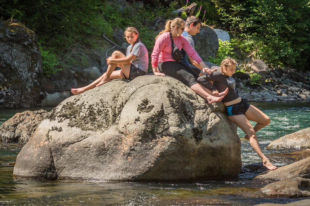 Kids climb atop a  rock on Washington's Snoqualmie River.