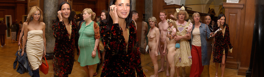 Sophie Anderton on phone. artist, Grayson Perry ( in drag)  with his wife Phillipa Perry, Opening of the Saatchi Gallery, County Hall. 15 April 2003. © Copyright Photograph by Dafydd Jones 66 Stockwell Park Rd. London SW9 0DA Tel 020 7733 0108 www.dafjones.com