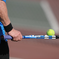 John Lyons balances the ball on his racket while playing tennis at Cal State Fullerton University.