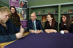 Pictured: The Miinister took time out to chat over a drink with Zlatina from Bulgaria, Simona from Italy, and Petr from the Czech Republic<br /> <br /> Migration minister Ben Macpherson visited social care provider Carr Gomm in Edinburgh today where he discussed with staff how proposed new UK immigration rules will hamper the recruitment of health and social care workers from outside the UK and Ireland. <br /> <br /> <br /> Ger Harley | EEm 21 March 2019