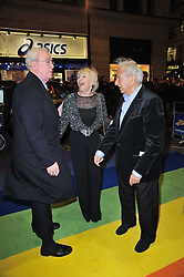 Left to right, MICHAEL CAINE, GERALDINE LYNTON-EDWARDS and MICHAEL WINNER arrive at the press night of the new Andrew Lloyd Webber  musical 'The Wizard of Oz' at The London Palladium, Argylle Street, London on 1st March 2011 followed by an aftershow party at One Marylebone, London NW1