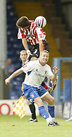 Photo: Aidan Ellis.<br /> Bury FC v Brentford. Coca Cola League 2. 01/09/2007.<br /> Brentford's Grant Basey gets above Bury's Glynn Hurst