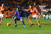 Blackpool Defender Clark Robertson challenges during the Sky Bet League 1 match between Blackpool and Oldham Athletic at Bloomfield Road, Blackpool, England on 16 February 2016. Photo by Pete Burns.