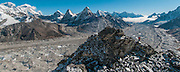 Nepal, Khumbu, Everest region, Pasang Sherpa on a day hike north of Gokyo, near the summit of Ngozuma Tse 5553m. Ngozumba Glacier is below, Everest is on the left