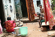 Neighbours of Budhia Singh, (right) 6, the famous Limca World Record marathoner, are preparing to have lunch in their house inside Salia Sahi slum (pop. 30.000) of Bhubaneswar, the capital of Orissa State, on Friday, May 16, 2008. On May 1, 2006, Budhia completed a record breaking 65 km run from Jagannath temple, Puri to Bhubaneswar. He was accompanied by his coach Biranchi Das and by the Central Reserve Police Force (CRPF). On 8th May 2006, a Government statement had ordered that he stopped running. The announcement came after doctors found the boy had high blood pressure and cardiological stress. As of 13th August 2007 Budhia's coach Biranchi Das was arrested by Indian police on suspicion of torture. Singh has accused his coach of beating him and withholding food. Das says Singh's family are making up charges as a result of a few petty rows. On April 13, Biranchi Das was shot dead in Bhubaneswar, in what is believed to be an event unconnected with Budhia, although the police is investigating the case and has made an arrest, a local goon named Raja Archary, which is now in police custody. **Italy and China Out**