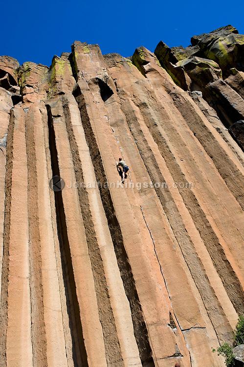 A mid adult man rock climbing a crack at Trout Creek, Oregon. (Model Released)