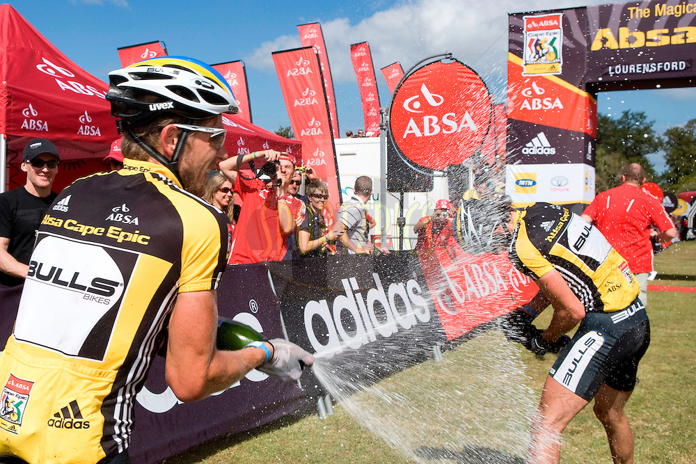 Karl Platt and Stefan Sahm of team Bulls 1 celebrate winning The 2010 Absa Cape Epic during the final stage (stage eight) of the 2010 Absa Cape Epic Mountain Bike stage race held between Oak Valley and Lourensford in the Western Cape, South Africa on the 28 March 2010.Photo by Karin Schermbrucker/SPORTZPICS.
