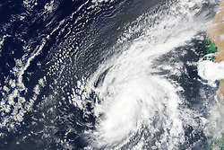 Hurricanes in the Atlantic Ocean typically start to develop off the west coast of Africa, then move westward across the basin and intensify as they approach North America or the islands of the Caribbean and Gulf of Mexico. In the last days of August 2015, that storm development process went into overdrive.<br /> On August 30, an easterly wave from the African interior moved out over the Atlantic, where sea surface temperatures hovered around 30° Celsius (86° Fahrenheit). The unusually warm waters provided fuel for a storm that progressed from tropical depression to tropical storm to hurricane in roughly one day.<br /> According to several reports, Fred appears to be the easternmost hurricane to form in the tropical Atlantic during the satellite era. (Extra-tropical Hurricane Vince formed briefly off Portugal in 2005.) It is also believed to be the first hurricane to hit Cabo Verde (Cape Verde) islands since 1892. The storm did not cause any casualties, nor did it make direct landfall on any of the islands, but it did cause flash flooding and extensive wind damage. As much rain was predicted to fall in one day as the islands typically receive in half a year, though totals are not yet available.<br /> The Moderate Resolution Imaging Spectroradiometer (MODIS) on NASA's Terra satellite acquired this natural-color image of Fred off the west coast Africa at 11:15 a.m. Cabo Verde time (12:15 Universal Time) on August 31, 2015. The storm was at peak intensity when the image was acquired, with sustained wind speeds of 75 knots (85 miles or 140 kilometers per hour) and a central pressure of 986 millibars. It was a category 1 storm on the Saffir-Simpson scale.<br /> The MODIS instrument on Terra got a look at Fred's remnants on September 1. Now a tropical storm, it is expected to linger for much of the week and slowly devolve into a tropical depression as it moves north and west.<br /> References<br /> BBC (2015, September 1)<br /> Hurricane Fred hits Cape Verde. Accessed September 1, 2015.<br /> Bloomberg News (2015, Sep