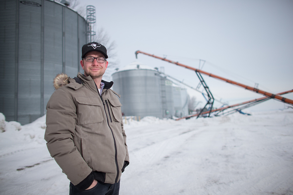Corn producer Dave Park of Parkland Farms in Sarnia Ontario, stands near his bins February 4, 2014. While Park plans to keep approximately the same acreage of corn next season others have been forced to reduce the amount do to the nearly 40% drop in corn prices this winter.<br /> Farmers Forum/ Geoff Robins