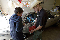 BERKELEY, CA - SEPTEMBER 1: (L-R) Jennifer     helps Lawrence Mady fill up his spare fuel can after filing up his diesel car with biodiesel fuel at the Biofuel Oasis on September 1, 2005 in Berkeley, California. WIth gas prices rising and tax incentives motorists are starting to turn to alternative means to fuel their vehicles.  (Photograph by David Paul Morris)