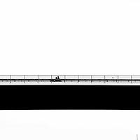 A motorcycle crossing a bridge over the River Elbe.