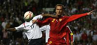 Photo: Paul Thomas.<br /> England v Macedonia. UEFA European Championships 2008 Qualifying. 07/10/2006.<br /> <br /> Jermain Defoe of England (L) battle with Nikolce Noveski.