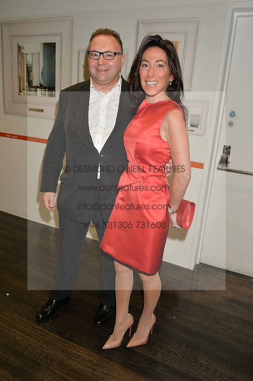 JONATHAN SHALIT and KATRINA SHALIT at the YOO 15 Anniversary Party hosted by John Hitchcox and Philippe Starck at Bankside, SE1 on 17th September 2014