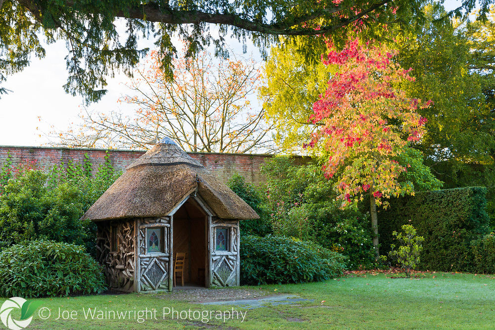 A miniature thatched cottage in the gardens of Erddig Hall, Wrexham, photographed in November