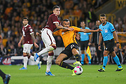 Daniele Baselli of Torino & Romain Saïss of Wolverhampton Wanderers during the Europa League play off leg 2 of 2 match between Wolverhampton Wanderers and Torino at Molineux, Wolverhampton, England on 29 August 2019.