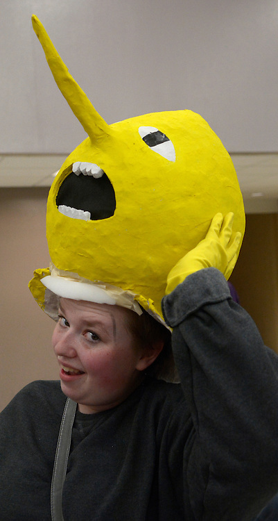 "gbs011517g/ASEC -- Danielle Sudlow of Albuquerque takes a breather and lifts off the home made papier mache head of Lemongrab, a character from Adventure Time TV program, at the Albuquerque Comic Con on Sunday, January 15, 2017. ""It's very hot but it's OK,"" she said (Greg Sorber/Albuquerque Journal)"