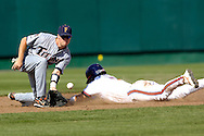 Clemson's Herman Demmink (R) slides into second base with stolen base in front of Cal State Fullerton shortstop Blake Davis (L) in the second inning.  Cal State Fullerton eliminated Clemson from the College World Series with a 7-6 win at Rosenblatt Stadium in Omaha, Nebraska, June 20, 2006.