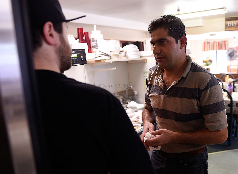 1005612433 :: 7/22/16 :: REGION :: LYNCH :: Hassan Mahmud rolls out pizza dough at House of Pizza on Old Norwich Rd. in Waterford Friday, July 22, 2016. Mahmud and his wife Fahima Jmoo and their children Hanif, Fidan and Fulla  are refugees from the conflict in Syria and lived for three years in Turkey before finally receiving approval to come to the United States. Ledyard Congregational Church is hosting the family and providing support. (Sean D. Elliot/The Day)