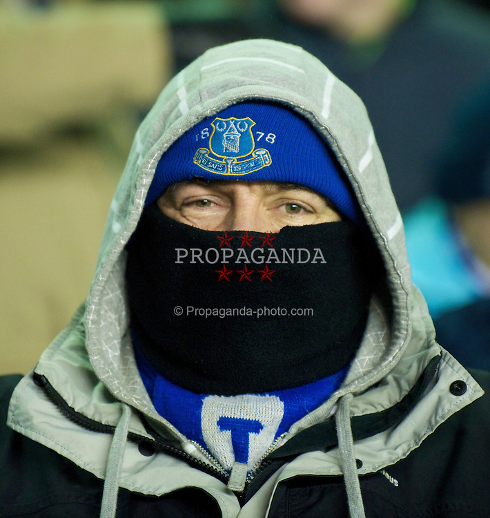 LIVERPOOL, ENGLAND - Thursday, December 17, 2009: An Everton supporter keeps warm during the UEFA Europa League Group I match against FC BATE Borisov at Goodison Park. (Pic by David Rawcliffe/Propaganda)