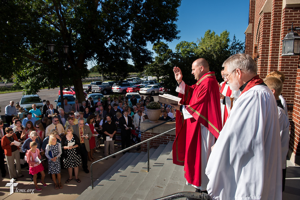 The Rev. Benjamin Ball opens the church doors at the beginning of a Divine Service of Rededication at St. Paul Lutheran Church in Hamel, Ill., on Sunday, Sept. 7, 2014. LCMS Communications/Erik M. Lunsford