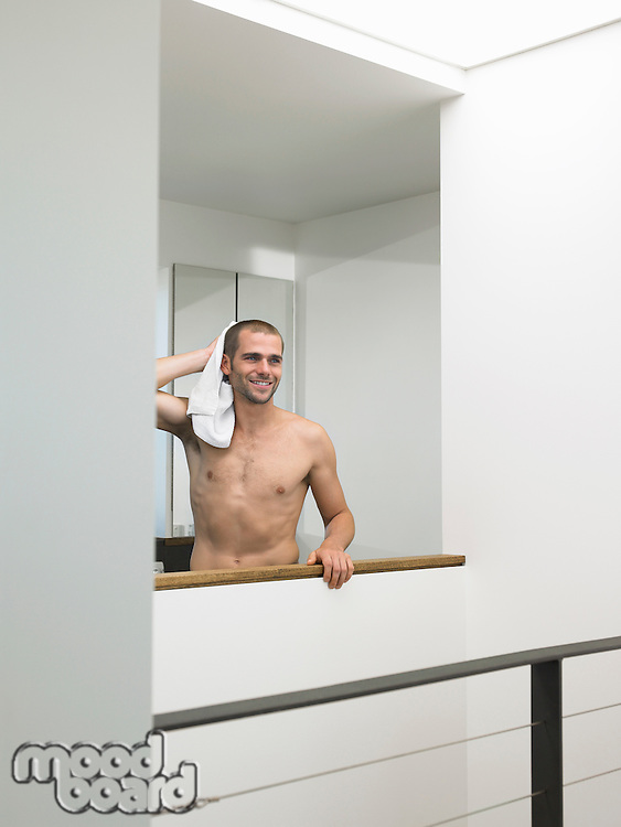Bare-chested Man With Towel in Modern House