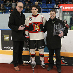 Newmarket, ON  - MAR 8,  2018: Ontario Junior Hockey League, post-season first round. Game four of the best of seven series between the Markham Royals and the Newmarket Hurricanes. OJHL Director of Communications Jim Mason and Hurricanes GM Eric Cella present the Kewl Sports player of the month award for the Month of November to Alex Ierullo.<br /> (Photo by Tim Bates / OJHL Images)