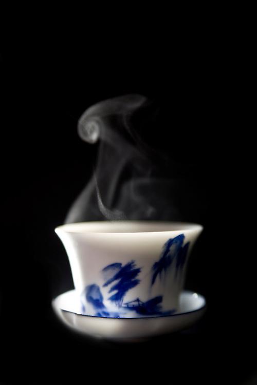 steaming tea in a gaiwan.
