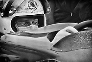 During the 1972 United States Grand Prix, French Marlboro-BRM F1 driver Jean Pierre Beltoise tries to become comfortable with a fitted aerodynamic &quot;shelf&quot; installed on his P180 chassis. <br />