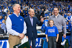 Keeneland President Bill Thomasson, left, talks with UK President Eli Capilouto, center and Keeneland VP Vince Gabbert and his daughter<br /> <br /> The University of Kentucky hosted the LSU Tigers, Saturday, March 05, 2016 at Rupp Arena in Lexington .