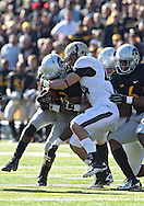 November 10 2012: Iowa Hawkeyes running back Damon Bullock (32) is hit by Purdue Boilermakers safety Landon Feichter (44) on a run during the NCAA football game between the Purdue Boilermakers and the Iowa Hawkeyes at Kinnick Stadium in Iowa City, Iowa on Saturday, November 10, 2012. Purdue defeated Iowa 27-24.
