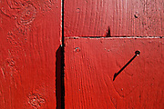 Nail in a red barn at Heath Fairgrounds in Heath, Massachusetts.