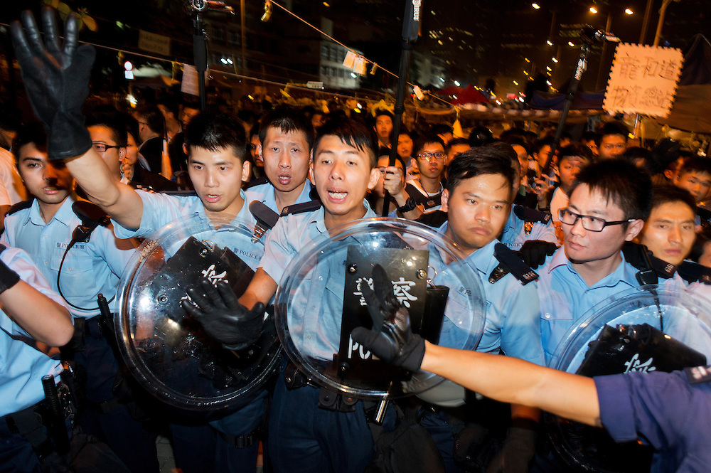 Tense confrontation on Tamar park next to HK government offices. Police forces facing demonstrators<br /> <br /> 17th day of pro-democracy protest in Hong Kong