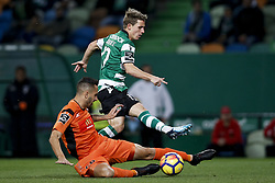 December 17, 2017 - Lisbon, Portugal - Sporting's forward Daniel Podence  (B) vies for the ball with Portimonense's defender Ruben Fernandes (F)  during Primeira Liga 2017/18 match between Sporting CP vs Portimonense SC, in Lisbon, on December 17, 2017. (Credit Image: © Carlos Palma/NurPhoto via ZUMA Press)