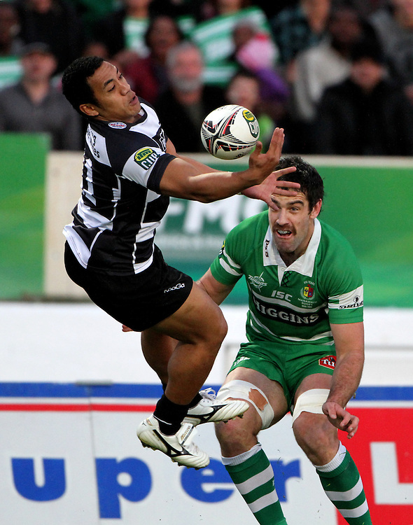 Hawkes Bay's Sinoti Sinoti takes the ball as he is tackled by Manawatu's Nick crosswell in the ITM Cup Championship rugby final at Palmerston North, New Zealand, Sunday September 04, 2011. Photo: SNPA / John Cowpland