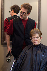 Vicco Mayor Johnny Cummings styles Sally Kemerer's hair, Wednesday, Jan. 16, 2013 at Scissors Salon in Vicco.