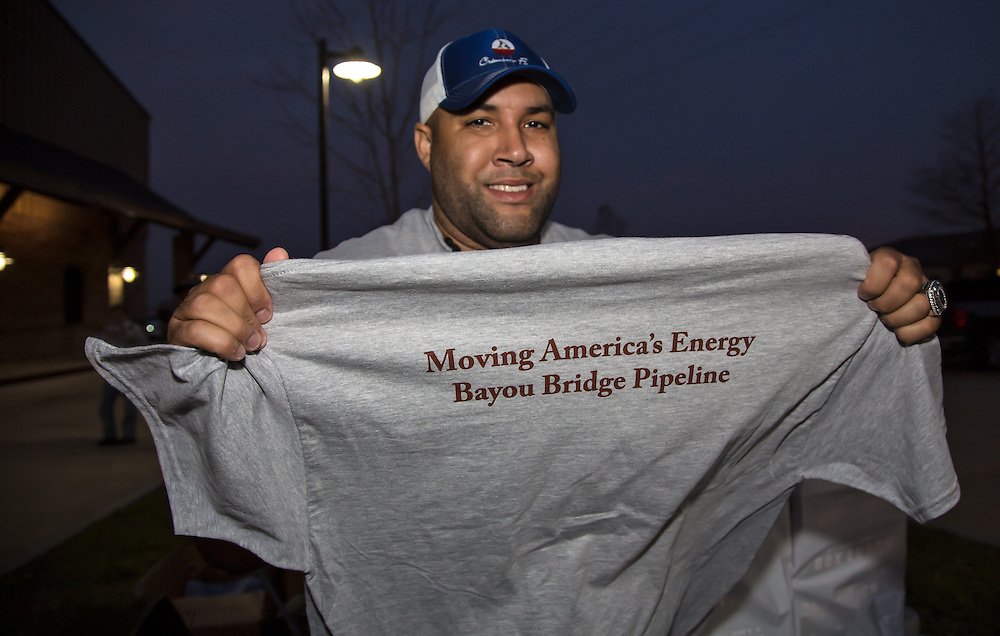 Supporters of the pipeline giving out t-shirts that support the Bayou Bridge pipeline project before the second permit hearing began.