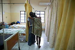 Already in labor, a young woman leans on a friend in the ante-natal ward at Juba Teaching Hospital. South Sudan has one of the highest maternal mortality rates in the world, and very few women have access to the kind of medical professionals who work at the hospital.